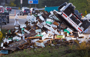 A semi-truck rolled early Friday morning, spilling a load of honeybees on the Interstate 5 median at the Interstate 405 interchange near Lynnwood. The truck held 458 hives holding as many as 14 million bees. The honeybees, headed from Sunnyside to a blueberry farm in Lynden, were worth $92,000.  (Mike Siegel / The Seattle Times)